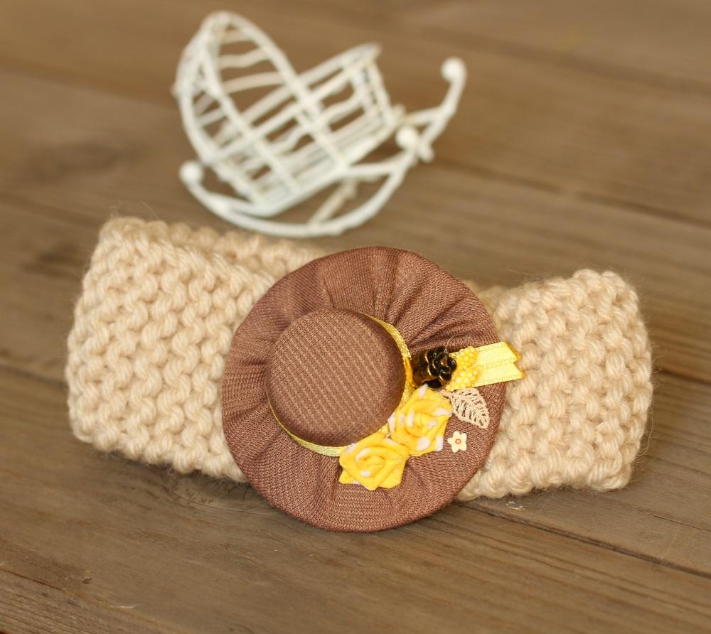 Плетен аксесоар за бебе